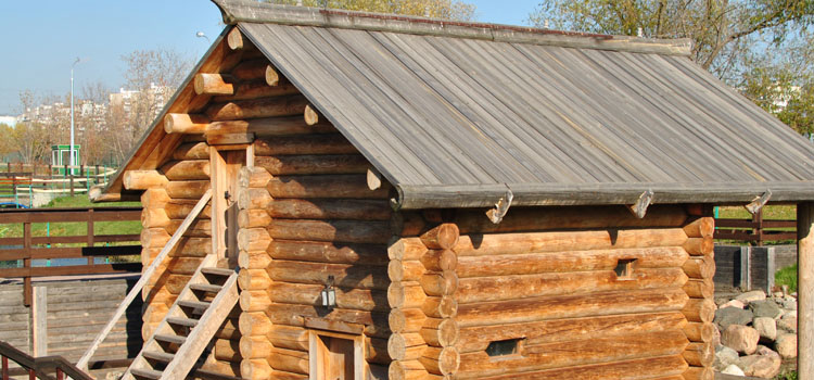 Traditional Russian wooden log house-room, with stairs